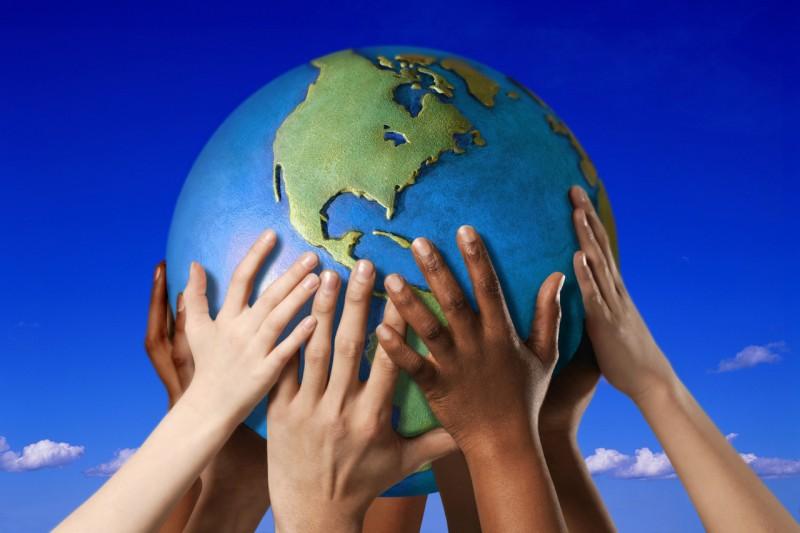 Hands holding globe